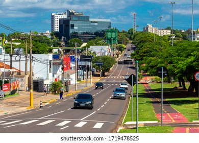 Campo Grande - MS, Brazil - April 30, 2020: Downtown, transit on the avenue and the local commerce around at Afonso Pena avenue. Tree-lined avenue. Main streets of the city.