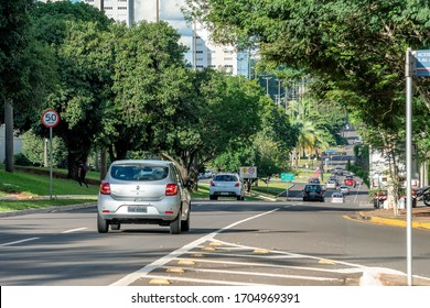 Campo Grande - MS, Brazil - March 30, 2020: Traffic of cars at Afonso Pena avenue, the main avenue of the city surrounded by big trees and large streets. Wooded city.