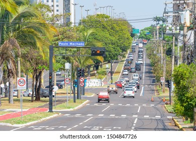 Campo Grande - MS, Brazil - September 13, 2019: Traffic at the Afonso Pena avenue, the main avenue of the city. Tree-lined large avenue.