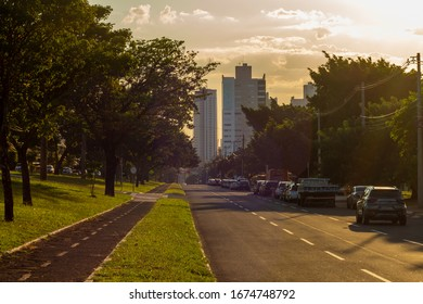 Campo Grande - MS, Mato Grosso do Sul, Brazil - March 15, 2020: Traffic on the main avenue, Altos da Afonso Pena avenue with sunset. Tree lined avenue with large streets.
