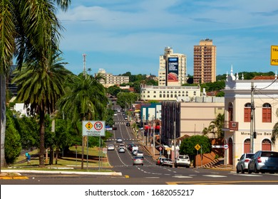 Campo Grande - MS, Mato Grosso do Sul, Brazil - March 15, 2020: Traffic on the main avenue, Afonso Pena avenue. Tree lined avenue with large streets.