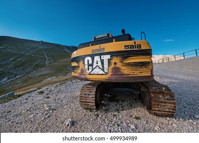 CAMPO IMPERATORE, ITALY - SEPTEMBER 2, 2016: Caterpillar machinery. Caterpillar Inc., is an American corporation which designs, develops, engineers, manufactures, markets and sells machinery worldwide