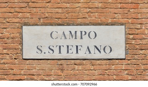 Campo Santo Stefano (Saint Stephen Square) old characteristic road sign on a brick wall in the historic center of Venice
