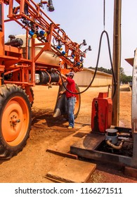 Campo Verde, Mato Grosso, Brazil, September 20, 2007. Farmer supplies biofuel with a sprayer machine on farm in Mato Grosso state