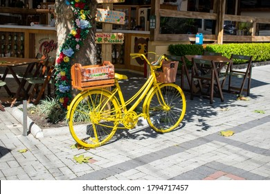 Campos do Jordão, São Paulo, Brazil - August 12, 2020: yellow bicycle advertising a restaurant in the tourist center of the city of Campos do Jordão.