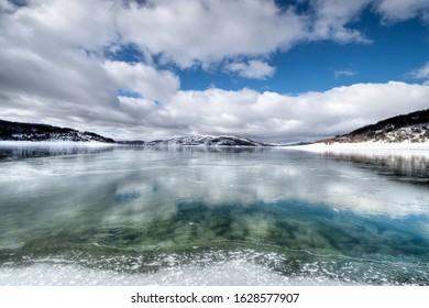 campotosto frozen lake in italy - abruzzo