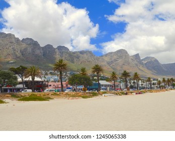 Camps Bay, a popular white sandy beach suburb of Cape Town with the famous 12 Apostles Mountains in the background. Cape Town, South Africa. November 2018