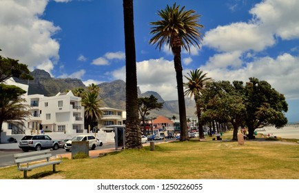CAMPS BAY, stretch of white sandy beaches and street lined with apartments and restaurants. Camps Bay, Cape Town, South Africa. December 2018