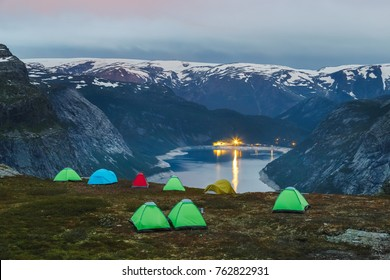 Campsite at the edge of cliff over Ringedalsvatnet lake nearby iconic landmark Trolltunga. Norway, Scandinavia, Europe. Famous and very popular travel destination in Norway for active people.