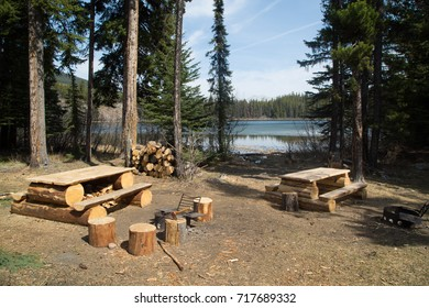 Campsite with firewood by the lake