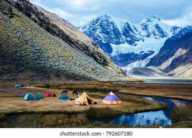 Campsite for trekking tours at the Laguna Jahuacocha on the Huayhuash Trek; Peru/ South America