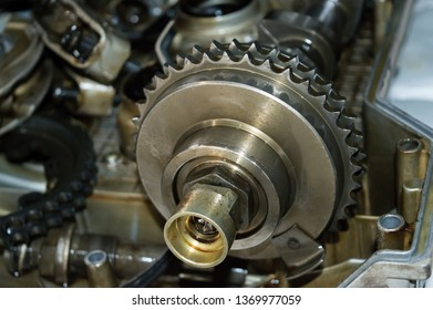 camshaft gear close-up, car engine part, nut and gear