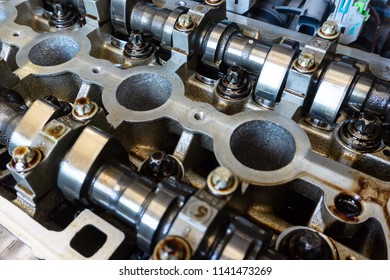 Camshafts and valve in oil on the car engine