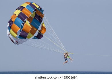 CAMYUVA, KEMER, TURKEY - JULY 16, 2015: The couple tourists flyes on parasailing. Parasailing is very popular in the Turkish resorts