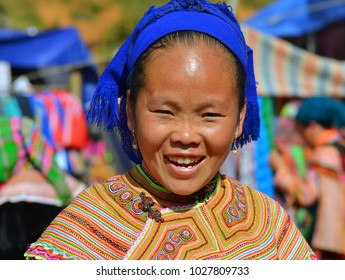 CAN CAO (CAN CAU), VIETNAM - NOV 10, 2012: Vietnamese Flower Hmong market woman in colorful traditional hill-tribe costume poses for the camera at Can Cau's lively Saturday market, on Nov 10, 2012.