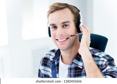Can I help You? Portrait of male customer support phone operator in headset, in smart casual wear. Consulting and assistance, service call center concept.