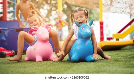 It can not always be your thing. Two little girl playing together on playground.