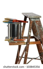Can of paint and paintbrushes over ladder isolated over white background