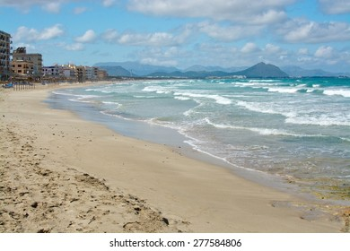 CAN PICAFORT, MALLORCA, SPAIN - APRIL 20, 2015: Can Picafort beach off season on a sunny spring day on April 20, 2015 in Can Picafort, Mallorca, Balearic islands, Spain.