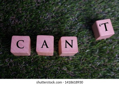 I can self motivation - cutting the letter t of the written word I can't so it says I can, goal achievement, potential, overcoming