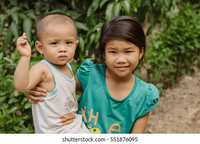 Can Tho, Vietnam - April, 02: Children on the streets of vietnamese village happy to see tourists. Rural life in Asia
