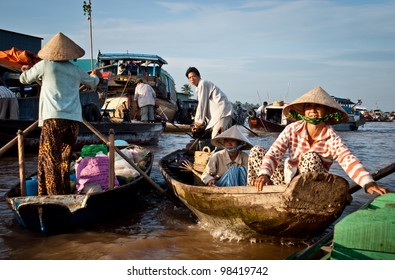 CAN THO, VIETNAM- AUG 27: Unidentified Vietnamese persons during the Floating Market in Can Tho, Vietnam on August 27, 2010. Cai Rang Market is the most important floating market on the Mekong Delta.