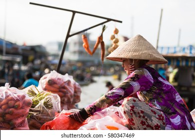 CAN THO, VIETNAM, FEB 5, 2017: A woman sell vegetables on the boat in floating market, Vietnam