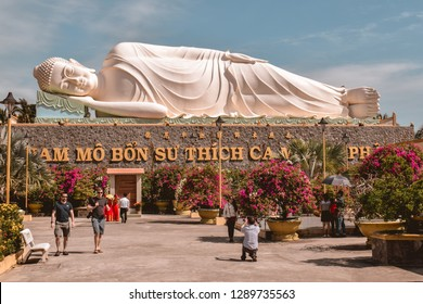 CAN THO, VIETNAM - FEBRUARY 18 2017: Big resting Buddha statue at the Vinh Trang pagoda in the Mekong Delta in Vietnam