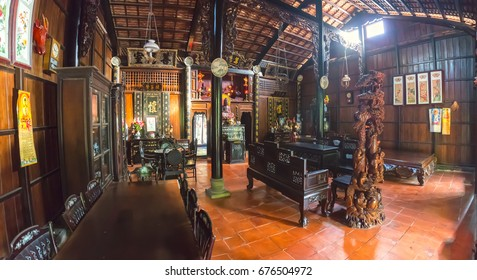 Can Tho, Vietnam - January 20th, 2017: Beauty of large old houses with wooden poles architecture, roof tiles, wood furniture show culture of the 19th century architecture in Can Tho, Vietnam