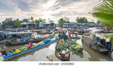 Can Tho, Vietnam - January 22, 2016: Farmers purchase crowded in floating market morning with dozens boats along river trade agricultural products serves traditional New Year in Can Tho, Vietnam