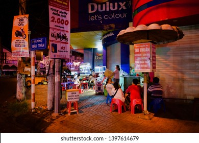 Can Tho, Vietnam - March 27, 2019: Typical ceremony of vietnamese peple at street cafe in the evening, Xuân Khánh district