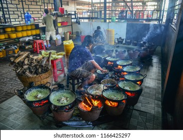 Can Tho, Vietnam - Sep 2, 2017. A local man making traditional pancake (Banh Xeo) at a local restaurant in Can Tho, Vietnam.