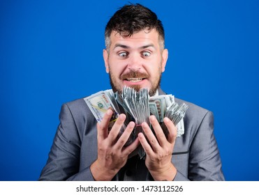 Can you imagine that. winning a lottery. businessman after great deal. Finance and commerce. happy bearded man has a lot of money. Billioner with dollar banknotes. Business and sport success.
