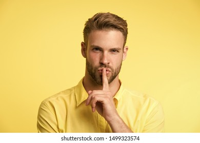 Can you keep secret. Handsome man keep index finger by his lips. Be silent. Secret story concept. Guy confident face just told his secret. Rumor legend and myth. Confidential information and secret.