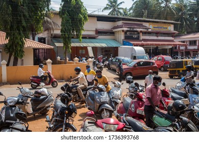 Canacona, Goa, India - 11 may 2020: Traffic and people in a small village in south India during the allocated grocery shopping time in the morning during the covid-19 lockdown.