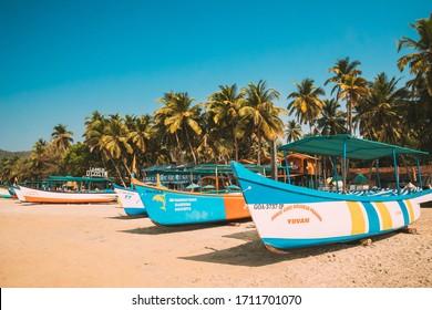 Canacona, Goa, India - February 16, 2020: Sightseeing Tourist Boats Parked On Famous Palolem Beach In Summer Sunny Day.