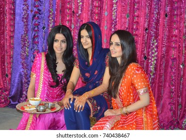 Canada 21 Apr 2017. Punjabi wedding in Vancouver Canada. Photo of bride in the middle and her two sisters. This is called amehndi ritual.