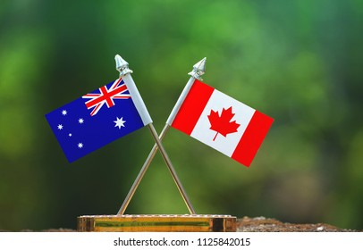 Canada and Australia small flag with blur green background