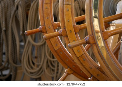 Canada, British Columbia, Victoria. Brass and wood steering wheel on the USCG Eagle is a three-masted sailing back home ported at the Coast Guard Academy in New London, Connecticut