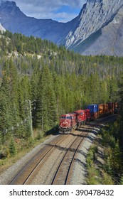 CANADA, BRITISH COLUMBIA, YOHO, 2014-09-27: Freight train passing through Yoho Nationalpark on its way to Golden