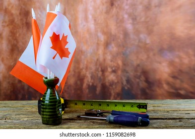 canada canadian flag labor day hammer, wrench wooden background. Labor day concept.