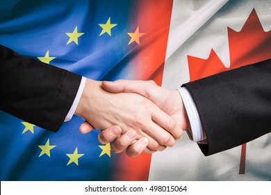 canada canadian partner european union euro eu rights usa ceta flag negotiation europa trade ttip economic business shake hand handshake concept - stock image