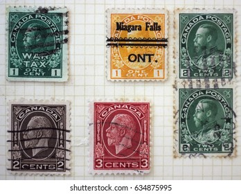 CANADA - CIRCA 1932: A set of postage stamps from Canada, one with a Niagara Falls postmark, depicting the profile of King George V, circa 1932