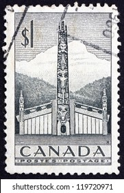 CANADA - CIRCA 1953: a stamp printed in the Canada shows Pacific Coast Indian House and Totem Pole, circa 1953