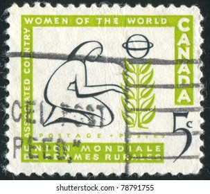 CANADA - CIRCA 1959: stamp printed by Canada, shows Woman Tending Tree, circa 1959