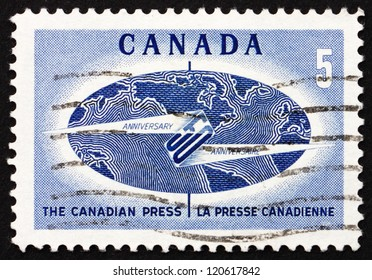 CANADA - CIRCA 1967: a stamp printed in the Canada shows Globe and Flash, 50th Anniversary of the Canadian Press, News Gathering and Distributing Service, circa 1967
