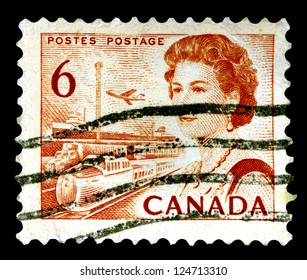 """CANADA - CIRCA 1967: A stamp printed in Canada shows Portrait of Queen Elizabeth II and Transportation means, without inscriptions, from the series """"Canada�s centenary as a nation"""", circa 1967"""