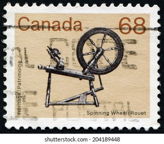 CANADA - CIRCA 1985: a stamp printed in the Canada shows Spinning Wheel, Heritage, circa 1985