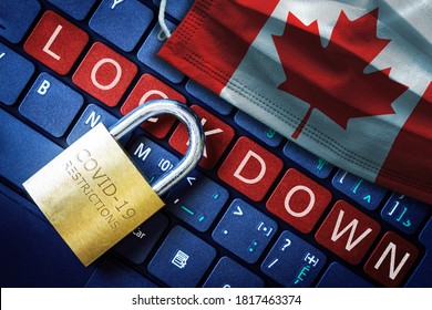 Canada COVID-19 coronavirus lockdown restrictions concept illustrated by padlock on laptop red alert keyboard buttons and face mask with Canadian flag.