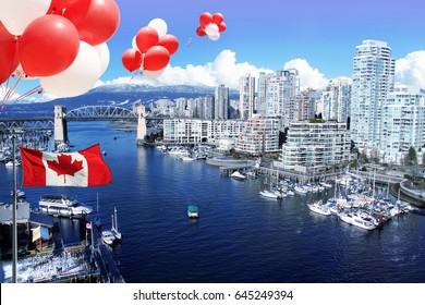 Canada day July 1. Canadian flag and balloons in front of view of False Creek and the Burrard street bridge in Vancouver, Canada.